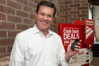 Cardlytics CEO Scott Grimes shows off its Bank of America mobile ad app, a platform open to the company's more than 400 banking clients.  Photo by Lorikay.